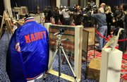 A New York Mets baseball jacket, personalized for Bernard Madoff, is displayed during an auction preview of his seized items in New York. Almost 200 items taken from the fallen financier's homes are being sold today.