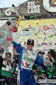 Carl Edwards celebrates in victory lane after winning the Able Body Labor 200 on Saturday in Avondale, Ariz.