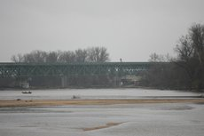 The first section implosion of the old I-70 bridge over the Kansas River went off with a quick blast in the rain.