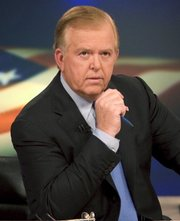 "News anchor Lou Dobbs sits on the set of his show, ""Lou Dobbs Tonight,"" in New York in this 2005 file photo."