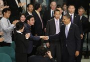 President Barack Obama arrives at a town-hall-style event with Chinese youths at the Museum of Science and Technology today in Shanghai.