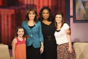 "Talk show host Oprah Winfrey, second from right, is pictured with with former Republican vice presidential candidate Sarah Palin and her daughters, Piper, left, and Willow, right, during the taping of ""The Oprah Winfrey Show"" in Chicago in this photo taken last week. Palin appeared on the show Monday."
