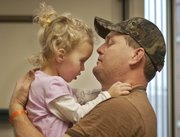 Jeff Sickman of Tonganoxie holds his daughter, Brooklyn, who is healing after a traumatic injury on Sept. 26.