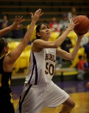 Haskell Indian Nations University's Maria Parker looks for a shot. Parker scored 17 points as HINU defeated Ottawa, 73-65, on Thursday night.
