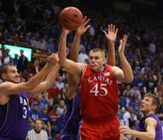 Kansas center Cole Aldrich battles for the ball with Central Arkansas players Mitch Reuter (34) and Jared Rehmel (10) during the first half, Thursday, Nov. 19, 2009 at Allen Fieldhouse.