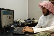 "Abdulmanam Almushawah, the head of a Saudi government program called Assakeena, checks radical Web sites Saturday in Riyadh, Saudi Arabia. Assakeena, Arabic for ""God's Presence,"" aims at combating Islamic militant Web sites."
