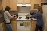 KU students Nina Riley, left, and Nancy Griego live, cook and blog the many recipes they use together.