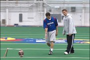 Kansas University's junior kicker Jacob Branstetter teaches reporter Mark Boyle the technique of kicking at the college level.