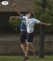 Ryan Bigley, left, and Axl Brammer both go up for the frisbee.
