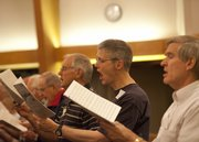 "Lawrence Civic choir tenors Larry McCullough, right, Matt Veatch, Gary Haworth and David Grove work through ""Beautiful Star"" during a rehearsal at First Baptist Church, 1330 Kasold Drive"