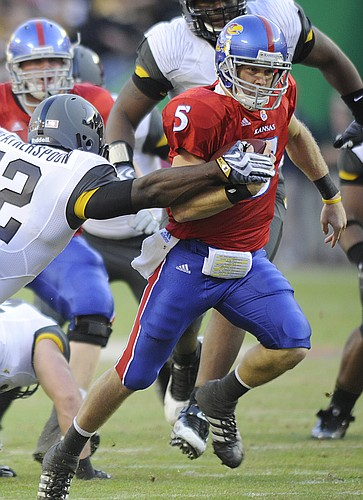Missouri's Sean Weatherspoon ties to knock the ball loose from KU quarterback Todd Reesing during the 2009 Border Showdown Saturday, Nov. 28, 2009 at Arrowhead Stadium.