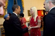 President Barack Obama greets  Michaele and Tareq Salahi, right, at a State Dinner hosted by Obama for Indian Prime Minister Manmohan Singh on Tuesday at the White House in Washington. The Secret Service is looking into its own security procedures after determining that the uninvited Virginia couple managed to slip into the dinner.