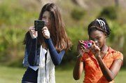 Wiregrass Ranch High School students Nicolette Doria, left, and Alexia Browne, use their cell phones to shoot photos during their science class Nov. 4 in Wesley Chapel, Fla.