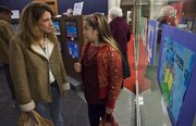 Gina Hill, left,  and Grace Goodwin attend the opening night   viewing Dec. 1.