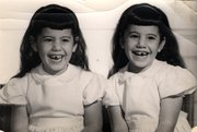 Alice and Mary Lieberman are not sure who's who in this picture, taken in 1957.  (Note the mirror image missing teeth.)