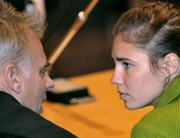 U.S. murder suspect Amanda Knox shares a word with her Italian lawyer Carlo Dalla Vedova, left, prior to a final hearing before the verdict Friday at the court in Perugia, Italy. Knox was found guilty of murdering her British roommate and sentenced to 26 years in prison.