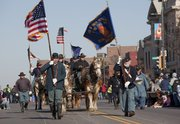 The Third Kansas Light Artillery during the 17th annual Lawrence Old-Fashioned Christmas Parade Saturday, Dec. 5.