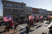 The Saddle and Sirlion Club with Old Glory during the 17th annual Lawrence Old-Fashioned Christmas Parade Saturday, Dec. 5.
