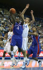 Kansas guard Sherron Collins elevates to the hoop past UCLA forward James Keefe during the first half, Sunday, Dec 6, 2009 at Pauley Pavilion.