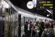 A train splashed with a green stripe carried 450 U.N. officials, delegates, climate activists and journalists from Brussels to the climate summit in Copenhagen on Saturday to symbolize efforts to reduce the convention's carbon footprint.