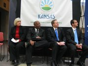 From left to right Carole Jordan, director of rural development with Kansas Department of Commerce; Kansas Secretary of Commerce Bill Thornton; Lt. Gov. Troy Findley; and Joe Monaco, spokesman for commerce, listen during news conference Monday to announce $2 million federal grant to improve broadband in Kansas. The state has contracted with Connected Nation to map the state's broadband infrastructure and help rural Internet access.