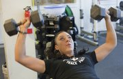Personal trainer Janice Boline of Next Level, 644 Locust, makes incline dumbbell presses part of her workout regimen.