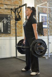 Janice Boline of Next Level, 644 Locust, makes a trap bar dead lift part of her workout regimen.