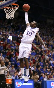 Kansas guard Tyshawn Taylor soars in for a dunk after a steal during the first half, Wednesday, Dec. 9, 2009 at Allen Fieldhouse.