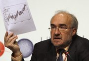 Michel Jarraud, Secretary-General of the World Meteorological Organization, holds a temperature chart during a news conference Tuesday at the U.N. Climate Conference in Copenhagen.