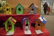 Activities at the KU Hilltop child development center produced birdhouses for an annual benefit auction. Some of samples from the collection are available for auction.