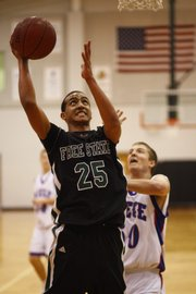 Free State's Sebastian Bonner (25) gets an open shot in the lane during the game against Meige on Saturday, Dec. 12, 2009, at Bonner Springs High School.