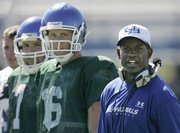University at Buffalo coach Turner Gill watches football practice with quarterback Drew Willy (16) and Tony Paoli (7) in Amherst, N.Y., Tuesday, Aug. 15, 2006.
