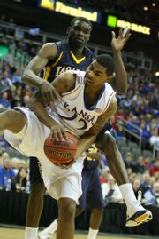 Kansas forward Marcus Morris tears away a rebound from La Salle forward Kimmani Barrett during the first half, Saturday, Dec. 12, 2009 at the Sprint Center in Kansas City, Mo.