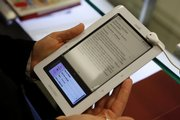 A customer tries out a Nook electronic book reader at Barnes and Nobles in New York. The Nook, Kindle and Sony Reader are in competition for the e-book market.