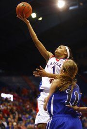 KU's Aishah Sutherland (1) puts up a fingerroll during the second half of the game against Creighton on Sunday, Dec. 13, 2009, at Allen Fieldhouse.