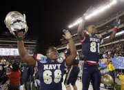 Navy's Curtis Bass, left, and Nick Henderson celebrate a 17-3 victory over Army on Saturday in Philadelphia.