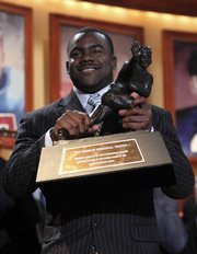 Alabama running back Mark Ingram holds up the Heisman Trophy after being named the winner Saturday in New York.
