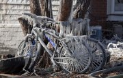 Bicycles coated in ice sit in the back of the home at 17th and Tennessee after it was destroyed in a fire Monday night.