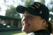 Iraqi war veteran and former Army Pvt. Margaret Ortiz, 27, sits in front of the women's shelter in Long Beach, Calif., earlier this month. The $15,000 Ortiz had in the bank when she left Iraq is long gone, spent on alcohol and cocaine. She joined a program called U.S. Vets to receive counseling and rehabilitation.