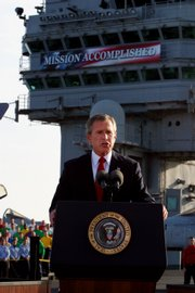 President George W. Bush declares the end of major combat in Iraq as he speaks aboard the aircraft carrier USS Abraham Lincoln off the California coast in this May 1, 2003, file photo.