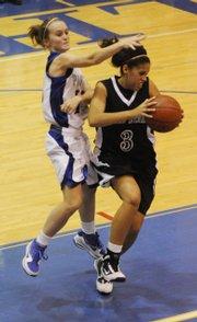 Free State's Amarra Lee (3) controls a rebound against Leavenworth's Amanda Parks (15) at Leavenworth High Friday December 18, 2009