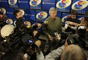 Newly-hired KU defensive coordinator Carl Torbush talks with media members during a news conference at Allen Fieldhouse shortly after his arrival into town, Friday, Dec. 18, 2009.