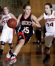 Lawrence High senior Haley Parker (25) drives around the Shawnee Mission Northwest defense in the second half Friday, Dec. 18.  The Lions lost to the Cougars, 47-35.