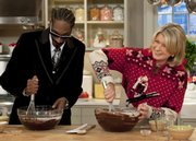 "Martha Stewart makes brownies with Snoop Dogg during an appearance on ""The Martha Stewart Show"" Tuesday in New York in this publicity image released by The Martha Stewart Show. Nine of this year's Crenshaw High School Cougars went through the Snoop Youth Football League, and the rapper is seen as a savior of sorts for football in an impoverished area of Los Angeles where gangs roam many of the streets."