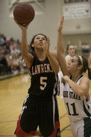 Lawrence's Jasmyn Turner (5) puts up a shot over Free State's Krista Seaman (11) during the game on Saturday, Dec. 19, 2009.