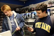 Brandon Siler, left, and Brenan Conroy browse through video games at Game Nut, 844 Mass.
