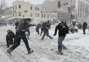 A group takes part in an impromptu snowball fight that took over the intersection of 14th and U Streets during a snow storm Saturday in Washington. The event was organized by a Twitter group calling for people to gather and participate and more than 200 people showed up.