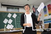 "Lawrence High School Anatomy Teacher Jo Huntsinger hands out review sheets for finals. Huntsinger, a 1978 LHS grad, says that she was initially intimidated by the prospect of teaching alongside her former professors. ""You learn what works and doesn't work for your personality, and by making mistakes,"" she says."