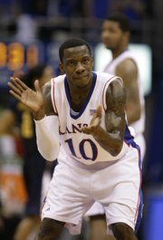 Kansas guard Tyshawn Taylor pumps up the Jayhawk defense during the first half, Tuesday, Dec. 22, 2009 at Allen Fieldhouse.