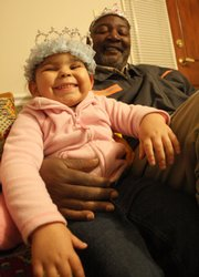 Joseph McKinley Williams Sr. with his 4-year-old granddaugther, Keyonna Renee.